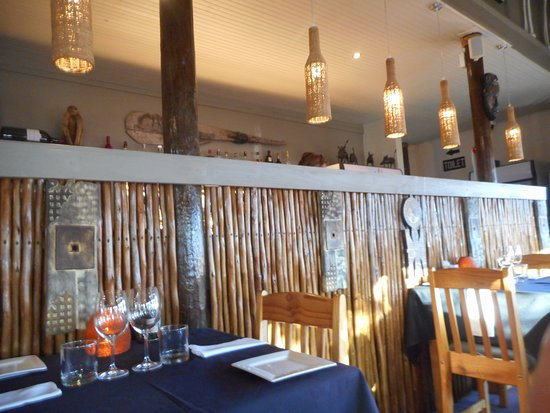 The Girl`s Restaurant: Seating by open bar & kitchen area - smells fantastic