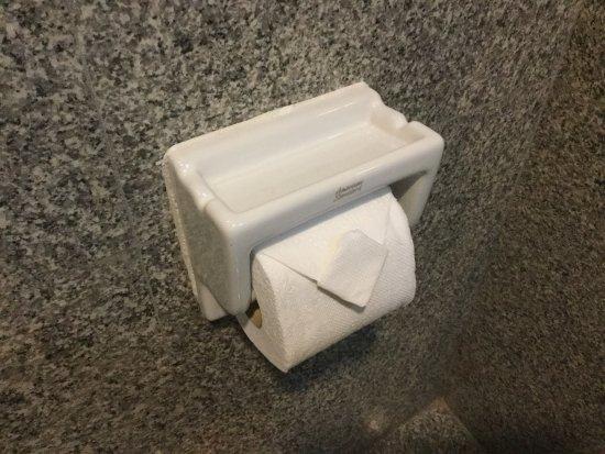 Loei Palace Hotel: An ashtray cum bog roll dispenser