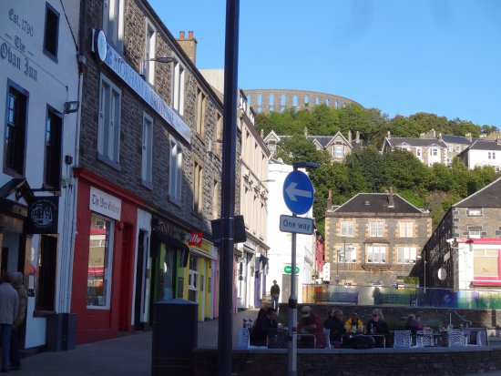 """McCaig's Tower: Looking up at the """"tower"""" from downtown Oban."""