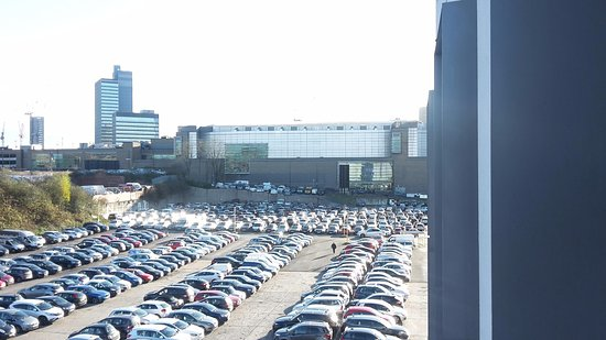 Travelodge Manchester Central Arena: car park with arena in background (white building)