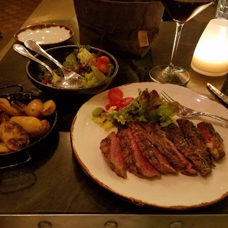 dry aged rib eye, roast potatoes , salad