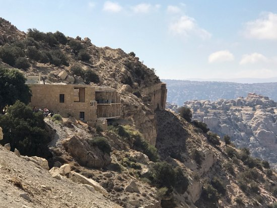 Dana guesthouse perched on the edge of the precipitous cliffs of Wadi Dana,