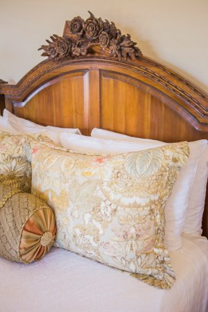 The Canyon Villa Hand Carved Headboard With European Linens