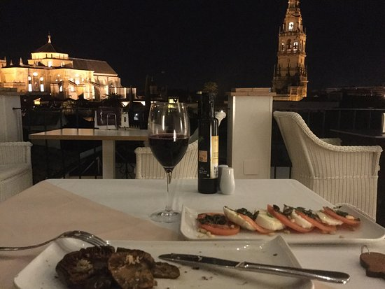 Balcon de Cordoba: Dinner: grilled mushrooms w/ shaved truffle & caprese salad on the balcony one December evening.
