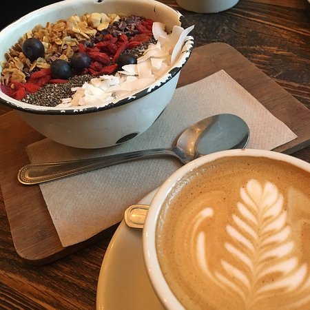 Distrikt Coffee: Flat White and Super Foods, yoghurt and granola.
