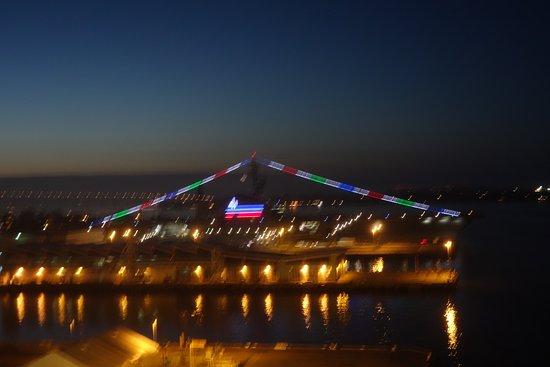 Coronado Bridge: Lights behind the Midway mark the bridge