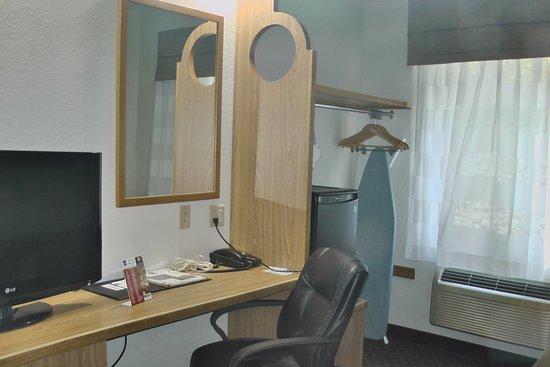 Sleep Inn : TV, closet, iron, ironing board and desk in room 104 October 2017