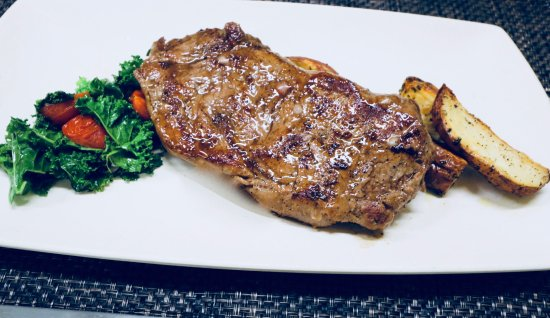 Sebring, FL: Certified Angus Beef 12 ounce N.Y. Strip  Roasted Potatoes, Sauteed Greens