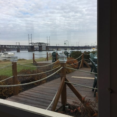 Tidewater Grille : View from the parking lot towards the entrance; view from our indoor seating; menu cover.