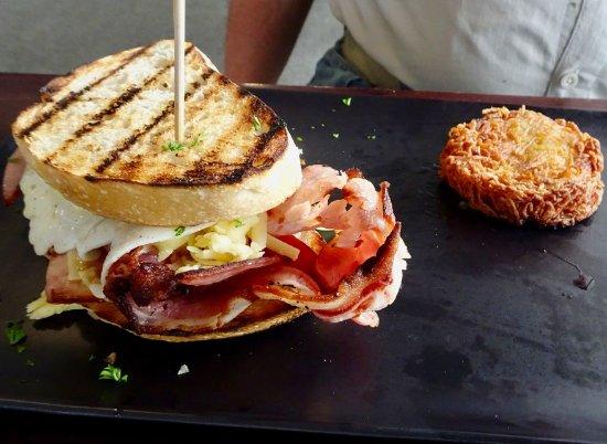 Paekakariki, New Zealand: Breakfast Sandwich with Bacon, Eggs, Cheese, and Rosti Potatoes