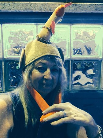 Seaside Grill: Andrea wearing her turkey hat for Thanksgiving dinner.....