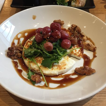 pan-fried manouri cheese with roasted black grapes, walnuts, baby kale, pomegranate molasses