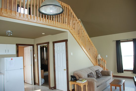 Charlo, Canada : Living area in A-Frame cottage and view of mezzanine