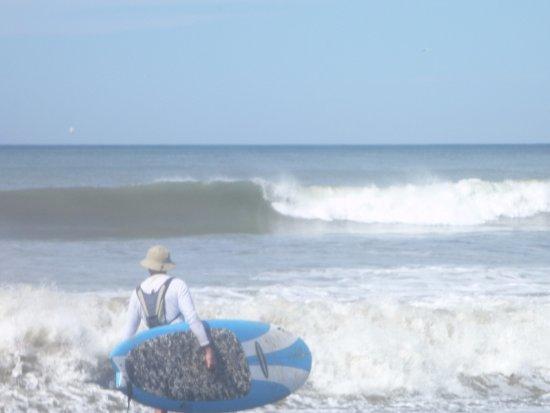 Experience Nosara Adventure Tours: SUP surfing Playa Nosara