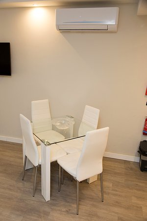 Dining Table & AC Unit - Picture of Onyx Apartments, Saint Julian\'s ...