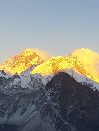Kathmandu Valley, Nepal: Everest like an erupting volcano at sunset from the top of Gokyo Ri