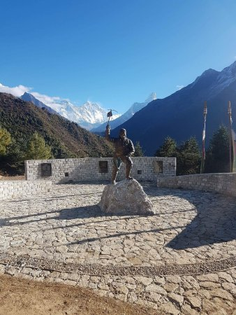 Kathmandu Valley, Nepal: Tenzing Norway memorial statue at Namche Bazaar with the Peak of Everest in the background