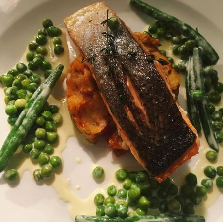 Forfar, UK : Honey and thyme glazed fillet of salmon, sun-dried potato cake and greens