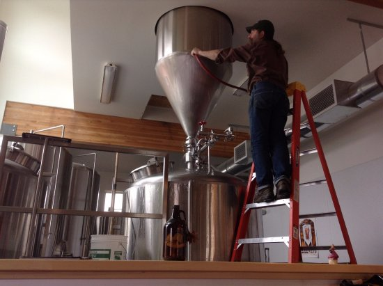 Haines, AK: Grain goes through the mill in the hopper, then gravity feeds into the mash tun