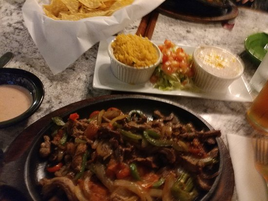 Shallotte, NC: Steak Fajita dish with beans, rice, and cheese dip