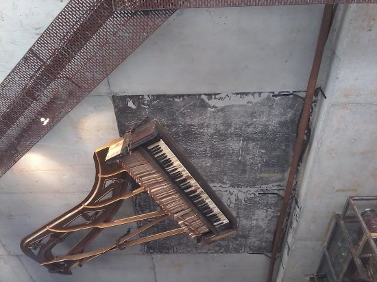Maroubra, Australia: Grand piano framework suspended from ceiling.