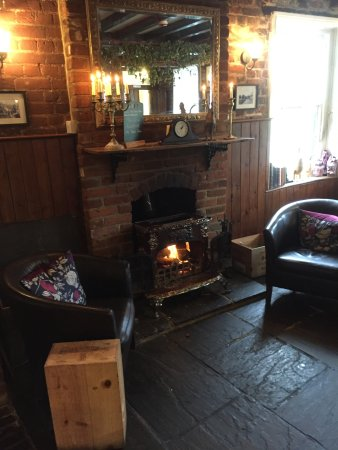 The Black Robin: Nice log fire in the bar area.