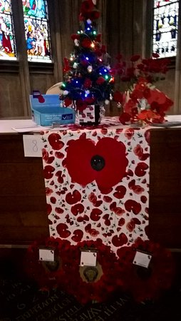 St Mary Redcliffe Church: Home made poppies sold in aid of the British Legion cover this tree