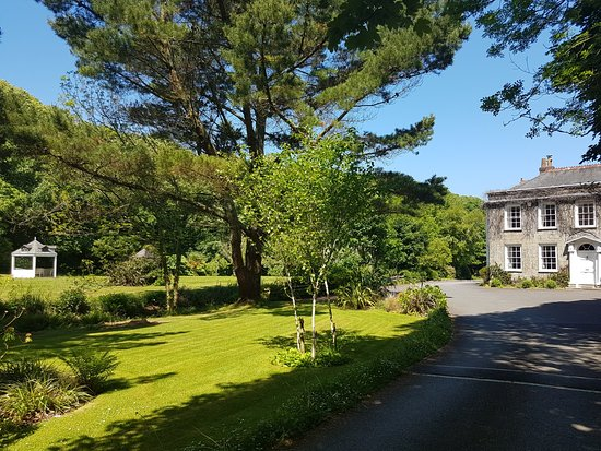 Rose in Vale Country House Hotel: Approach to the Hotel with Summer House across the stream