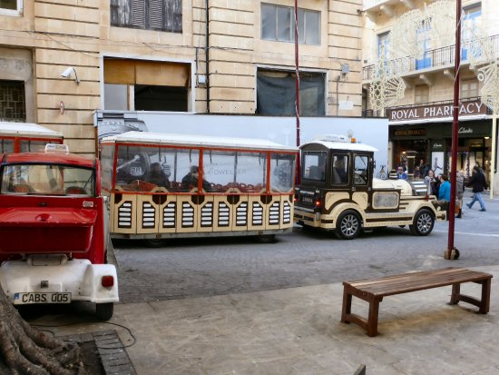 Malta Fun Trains: The train in St John Street passing the electric cab recharging point