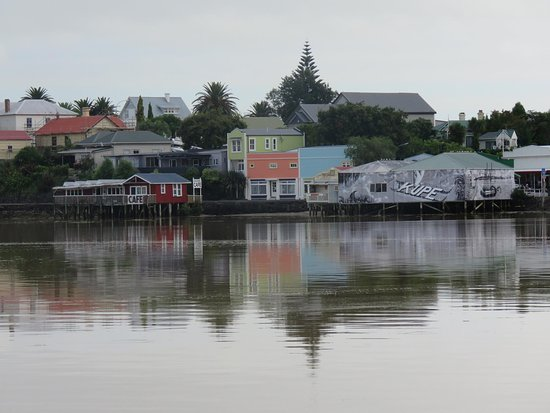 view from the HOkianga Harbour Rawene of the orange roofed Simply Fun shop front !