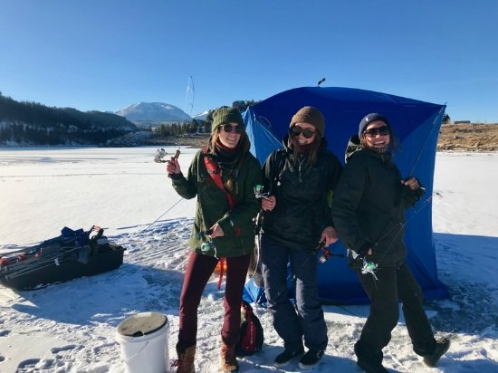 Dillon, CO: Silver Flask Fishing teaching customers how to ice fish