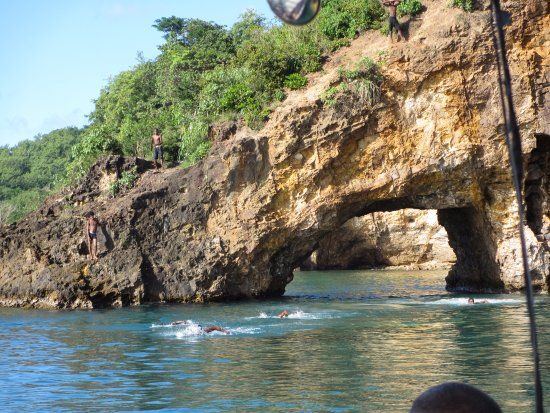 Vieux Fort, St. Lucia: Natural bridge formation on the St. Lucia coast - children were diving for our entertainment.