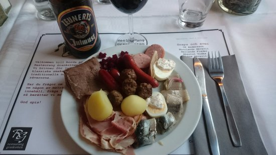 Sundsvall, Svezia: Plate from the Christmas smorgasbord with only a small selection from fish,cold cuts and hot