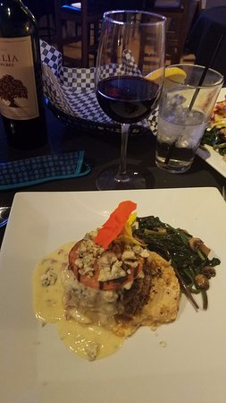 Corrales, NM: Blue cheese encrusted filet, roasted tomato, green chili potatoes with spinach & mushrooms