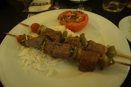 "Main course ""Rick's Filet de boeuf kebabs"", too well done and lack of taste"