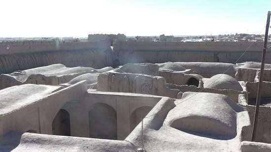 Ghoortan Citadel: You can see the curved roofs of the house and the wall behind
