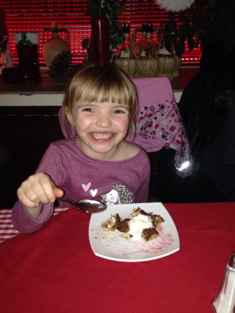 Wellingborough, UK: The face says it all. Enjoying Nutella Calzone at Rocco's.