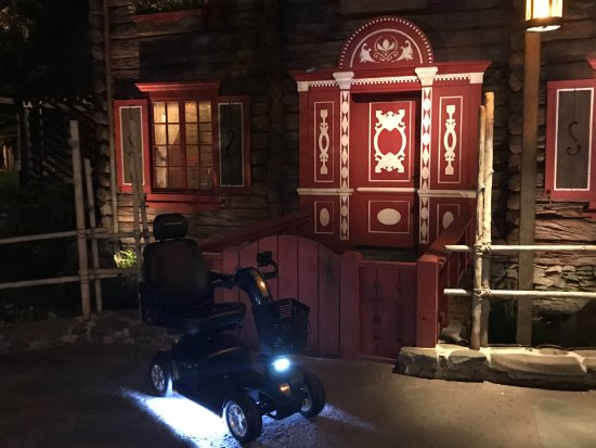 Gold Mobility Scooters: Rental Scooter Parked outside Frozen Ride at Disney Epcot