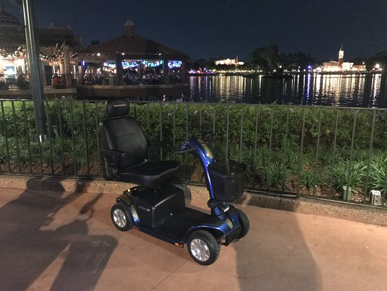 Rental scooter parked outside frozen ride at disney epcot for Motorized scooter disney world
