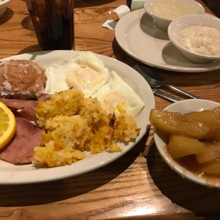 Grandville, MI: Holiday breakfast: ham, sausage, bacon, two eggs, grits, biscuits & gravy, cinnamon apples and a