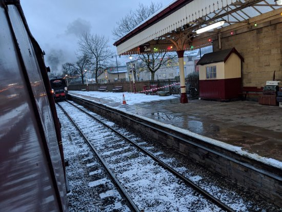 Ramsbottom, UK: city of wells passing by our train