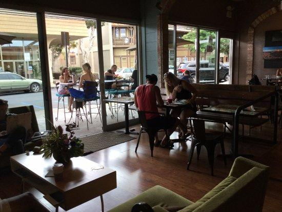 Wailuku Coffee Company: Waiting for our snacks, drinking coffee.