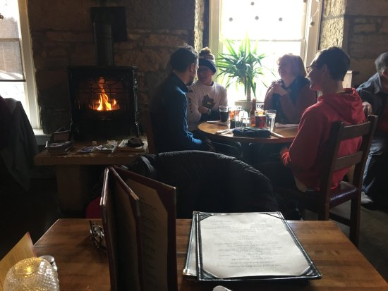 Mineral Point, WI: diners by fire in the small dining room