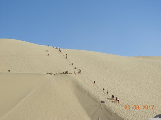 Dunhuang, China: Trekking up to the top of the dunes