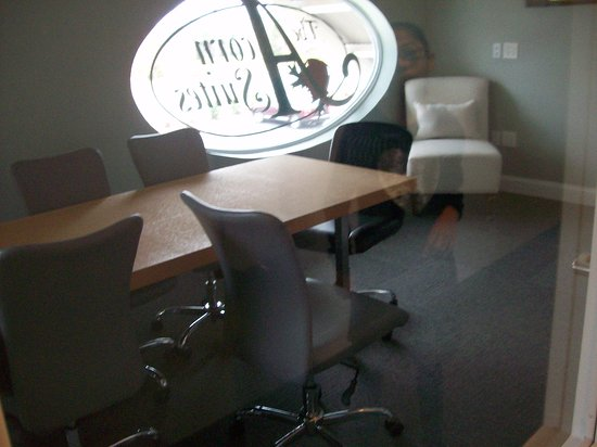 "Mebane, NC: The small conference room that shares the complimentary ""one"" computer Business Center."