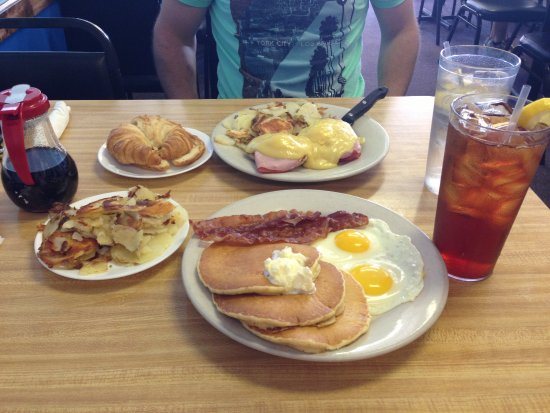 Port Orange, FL: Eggs benny, pancakes, croissant, eggs, bacon and home fries