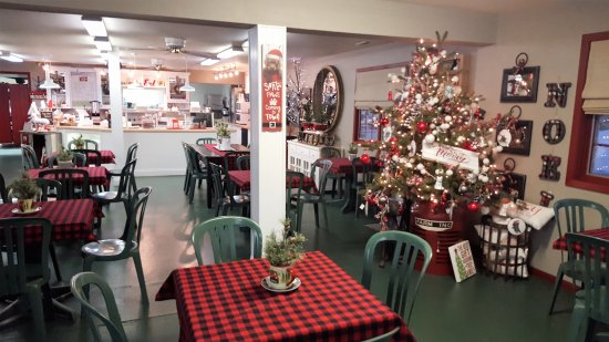Fort Dodge, IA: Dining room, with seating intermingled with Christmas decorations.