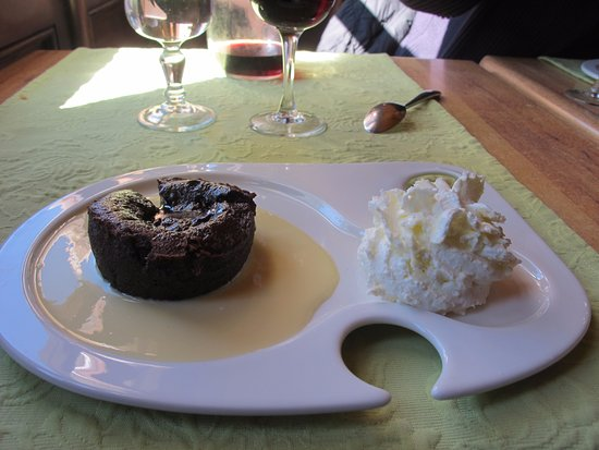 Molitg-les-Bains, France: Fondant Chocolat with vanilla sauce and fresh whipped cream