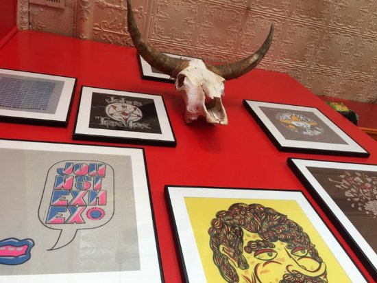 John's Tex-Mex Eatery: Wall art (possibly shirt designs)