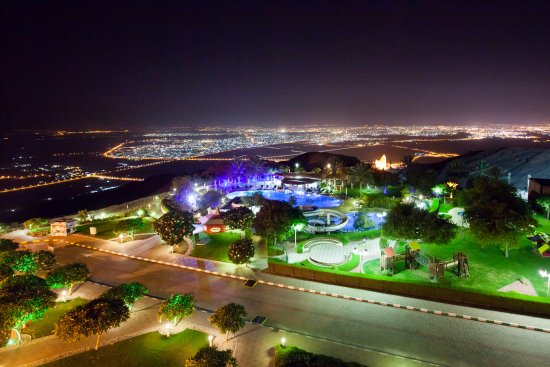 Mercure Grand Jebel Hafeet Al Ain: View of the pool from the room, and Al Ain below at the backdrop